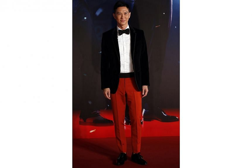 "Hong Kong actor Nick Cheung Ka-Fai, nominated for Best Actor for his role in ""Unbeatable"", poses on the red carpet during the 33rd Hong Kong Film Awards in Hong Kong on April 13, 2014. -- PHOTO: REUTERS"