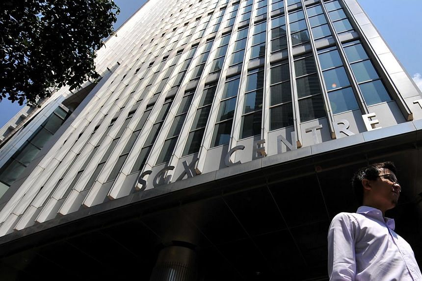 A man walks past the Singapore Exchange (SGX) building at Shenton Way. From Monday, April 14, 2014, the names of the companies listed on investors' Central Depository (CDP) statements will be the same as the names identified on their trading counters
