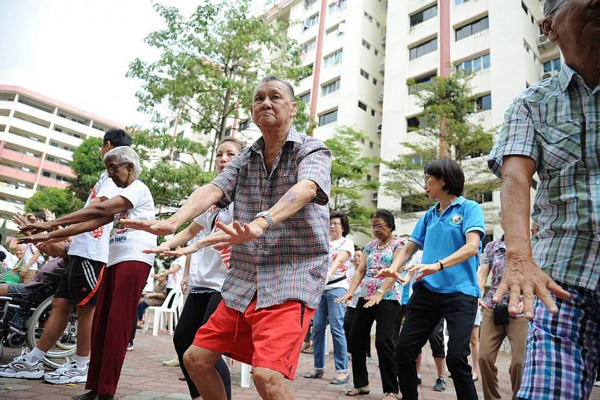 Residents of AWWA Community Home for Senior Citizens learning taiji with the help of volunteers from OCBC Bank. The residents will in turn impart the moves to others in need.