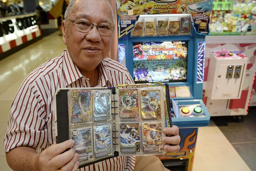 Patrons at Virtualand arcade in nex mall playing the Fish Hunter game, which is popular with senior citizens and housewives.  (Left) Mr George Gan, 68, with his collection of cards from the Animal Kaiser game.