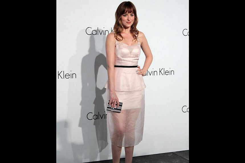 Actress Dakota Johnson (above) attended a glitzy party that included celebrities such as actress Zhang Ziyi, actor Louis Koo and singer Alex To. -- ST PHOTO: NEO XIAOBIN