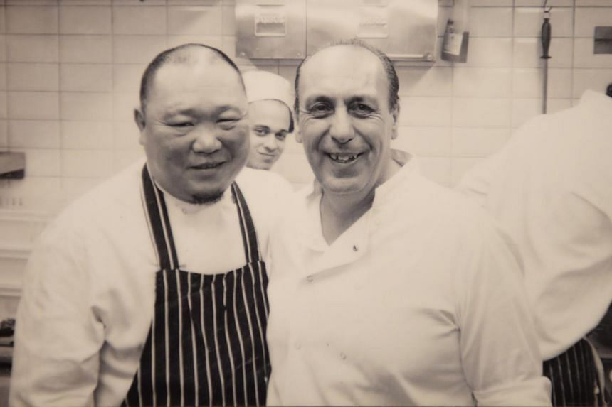 Mr Se Teo with chef Gennaro Contaldo (above), the mentor of Jamie Oliver, in London in 2006 and with staff of Eighteen Chefs. -- PHOTO: COURTESY OF BENNY SE TEO