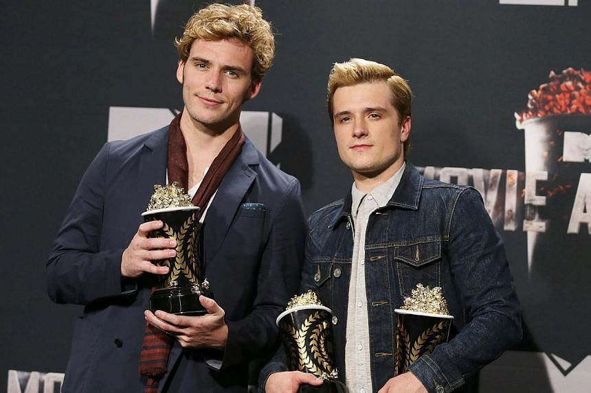 Actors Sam Claflin (left) and Josh Hutcherson pose backstage with their award for Best Movie of the Year and Hutcherson's award for Best Male Performance for the film The Hunger Games: Catching Fire at the 2014 MTV Movie Awards in Los Angeles, Califo