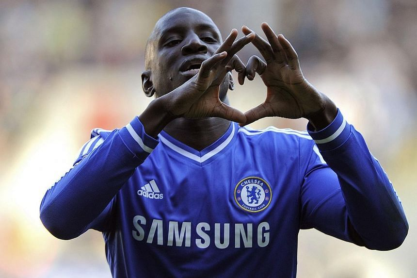 Chelsea's Demba Ba celebrates scoring a goal against Swansea City during their English Premier League match at the Liberty Stadium in Swansea, Wales, on April 13, 2014. -- PHOTO: REUTERS