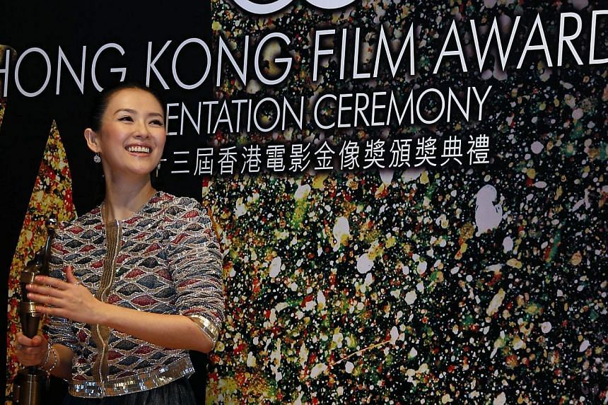"""Chinese actress Zhang Ziyi poses backstage after winning the Best Actress award for her role in the movie """"The Grandmaster"""" during the 33rd Hong Kong Film Awards in Hong Kong April 13, 2014. -- PHOTO: REUTERS"""