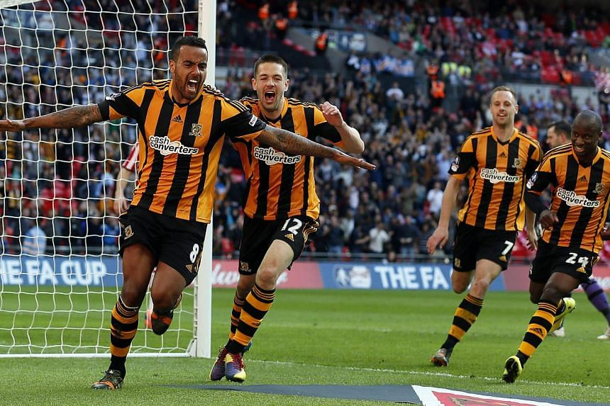 Hull City's Tom Huddlestone (left) celebrates with teammates after scoring against Sheffield United during their English FA Cup semi-final soccer match at Wembley Stadium in London on April 13, 2014. -- PHOTO: REUTERS
