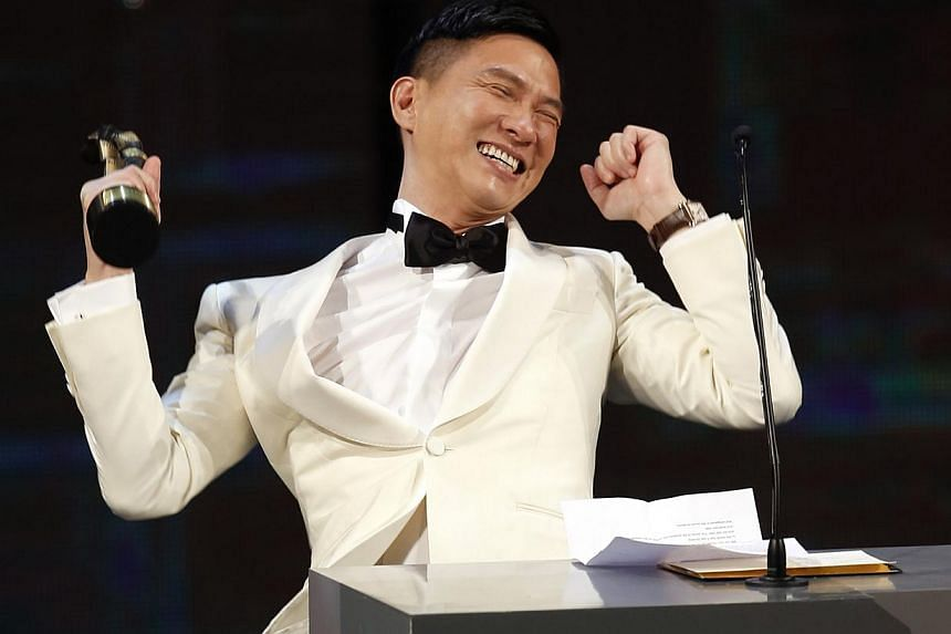 Hong Kong actor Nick Cheung celebrating after winning the Best Actor award for his work in the movie Unbeatable at the 33rd Hong Kong Film Awards on April 13, 2014. -- PHOTO: REUTERS