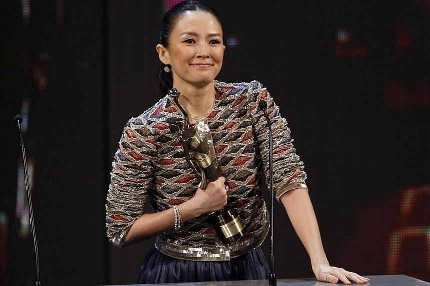 Chinese actress Zhang Ziyi celebrating after winning the Best Actress award for her work in the movie The Grandmaster at the 33rd Hong Kong Film Awards on April 13, 2014. -- PHOTO: REUTERS