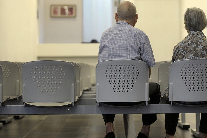 An elderly couple at the Choa Chu Kang Polyclinic. -- ST FILE PHOTO: JOSEPH NAIR