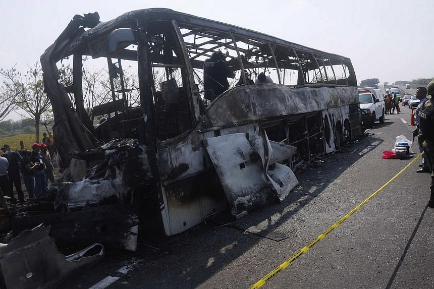 A burnt bus is seen after an accident on a highway near Juan Rodriguez Clara town, in Veracruz state, on April 13, 2014. At least 36 people were killed and four injured on Sunday in the eastern Mexico bus crash. -- PHOTO: REUTERS
