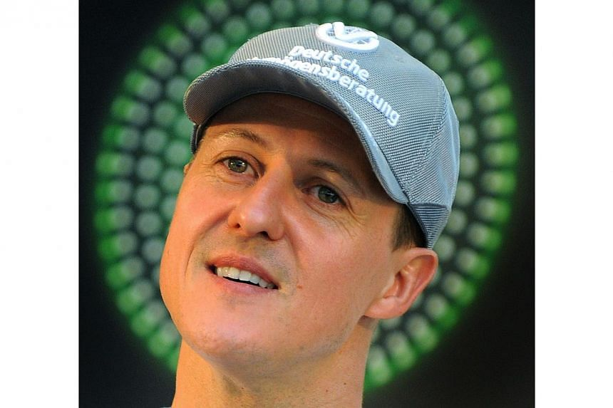 Michael Schumacher has had short moments of consciousness, says his spokesman. -- FILE PHOTO: AFP