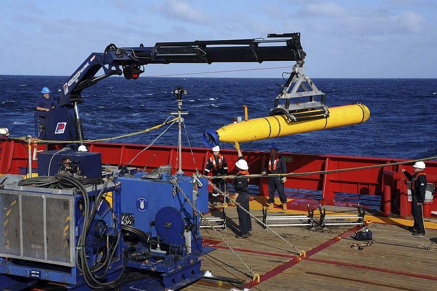 The Bluefin-21, the Artemis autonomous underwater vehicle, is hoisted back on board the Australian Defence Vessel Ocean Shield after a successful buoyancy test in the southern Indian Ocean as part of the continuing search for the missing Malaysian Ai