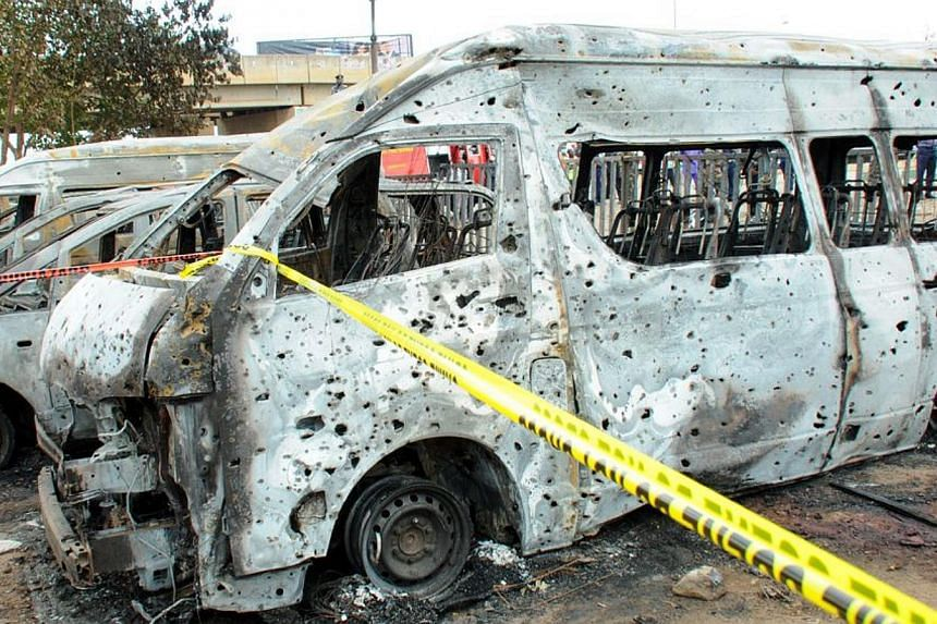 Burnt vehicles after an attack in Abuja, on April 14, 2014. A morning rush hour bomb killed at least 71 people at a Nigerian bus station on the outskirts of the capital on Monday, raising concerns about the spread of an Islamist insurgency after the