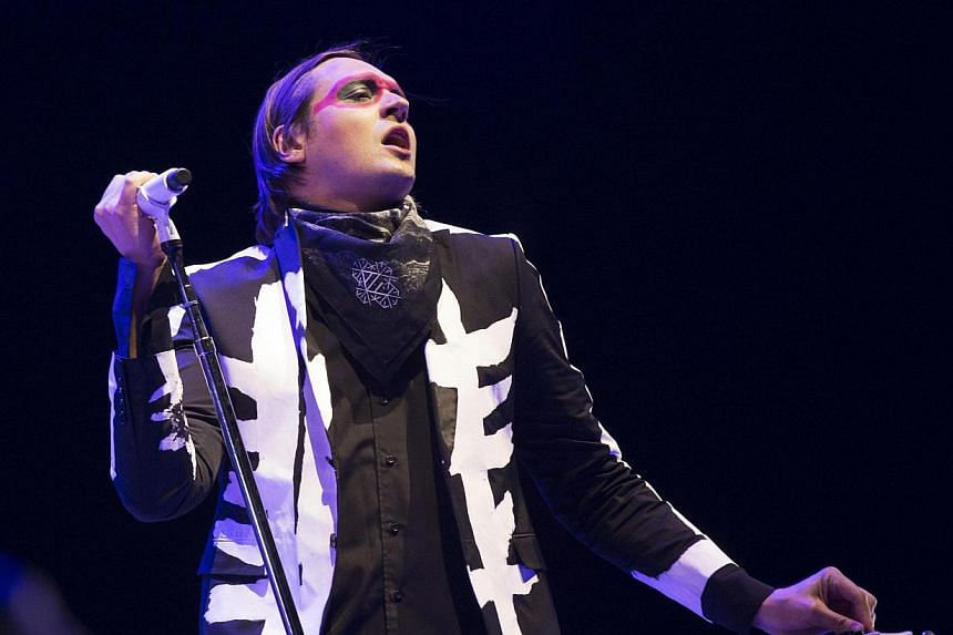 Lead vocalist Win Butler of rock band Arcade Fire performs at the Coachella Valley Music and Arts Festival in Indio, California on April 13, 2014. Canadian alternative-rock group Arcade Fire closed the Coachella Valley Music and Arts Festival on Sund