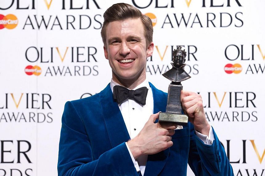 US actor Gavin Creel poses for pictures after winning Best Actor in Musical during the Lawrence Olivier Awards for theatre at the Royal Opera House in central London, on April 13, 2014. The London production of Book Of Mormon won Best New Musical at