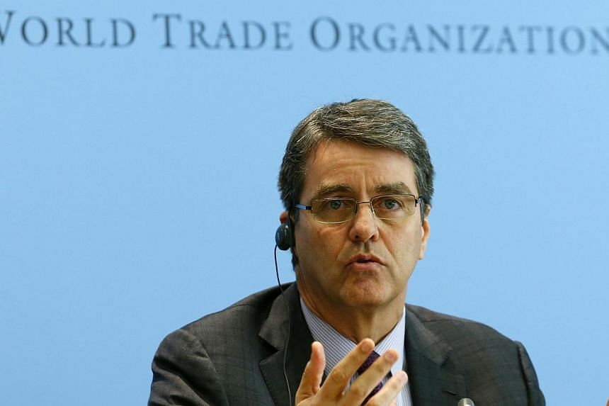 World Trade Organization (WTO) Director-General Roberto Azevedo gestures during a news conference on world trade in 2013 and prospect for 2014 in Geneva on April 14, 2014. Global commerce is set to grow by 4.7 per cent this year, the World Trade Orga