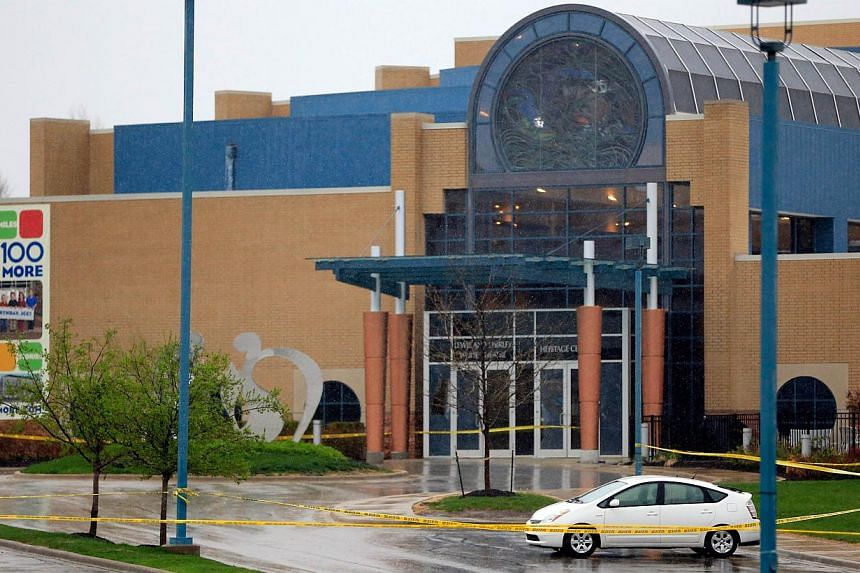 Police tape marks off the front of the Jewish Community Center after three people were killed when a gunman opened fire in Overland Park, Kansas, on April 13, 2014. -- PHOTO: AFP