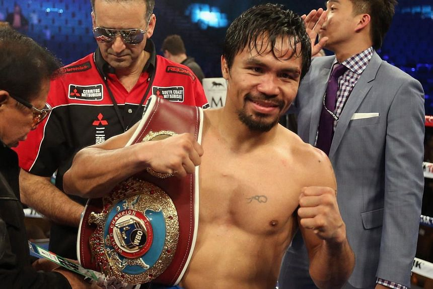 Manny Pacquiao celebrates his victory over Timothy Bradley at the MGM Grand Garden Arena in Las Vegas, Nevada, on April 12, 2014. -- PHOTO: AFP