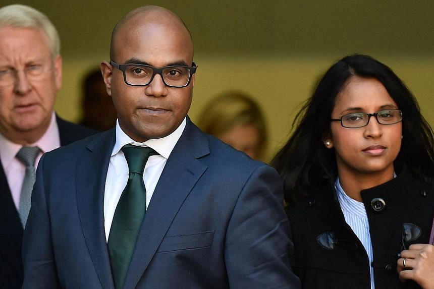Doctor Dhanuson Dharmasena (Center) leaves following a hearing where he faced charges under the Female Genital Mutilation Act at Westminster Magistrates Court in London on April 15, 2014.  A doctor will be one of two men to be tried in the