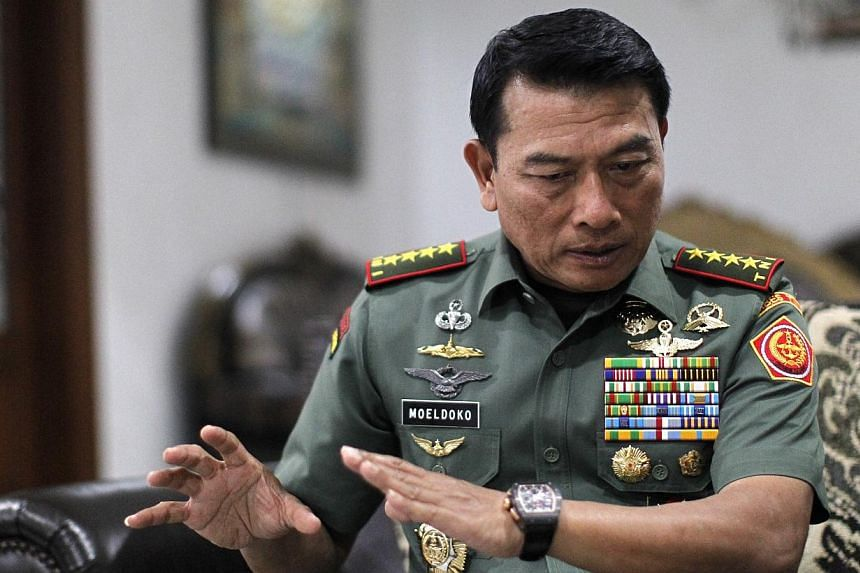 Indonesia's armed forces commander General Moeldoko, seen in this March 25, 2014, photo, has apologised for the naming of a new frigate after two marines responsible for a bombing in Singapore's Orchard Road in 1965. -- ST PHOTO: KEVIN LIM