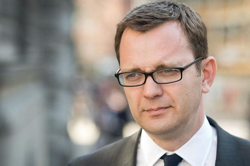 Former News of the World editor and Downing Street communications chief Andy Coulson leaves the phone-hacking trial at the Old Bailey court in London on April 14, 2014. -- PHOTO: AFP