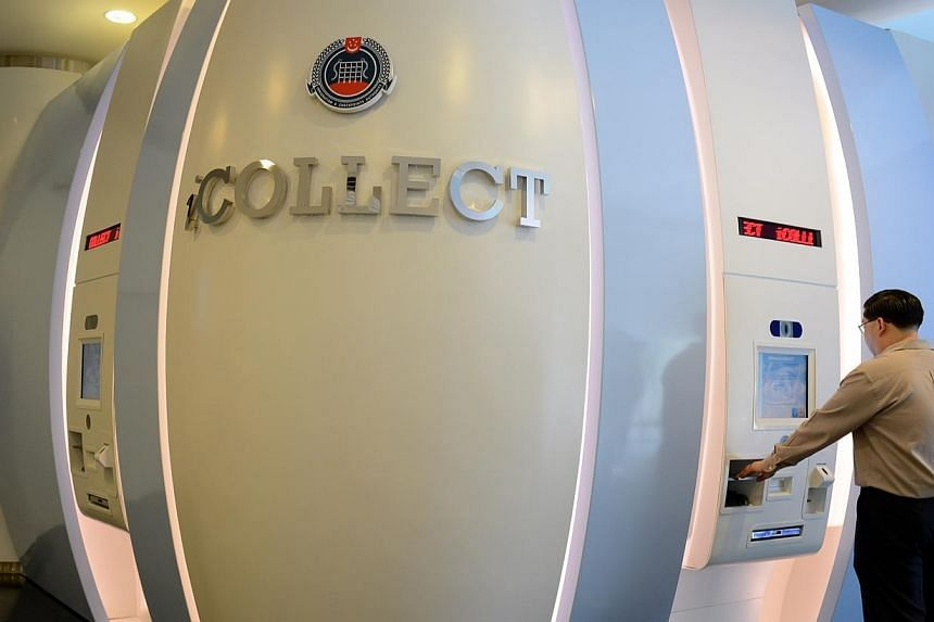 iCollect, a self-service kiosk at the eLobby@ICA, located on the ground floor of the Immigration and Checkpoints Authority, ICA Building. -- ST FILE PHOTO:AZIZ HUSSIN