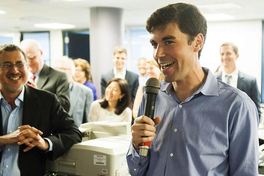 Washington Post reporters Barton Gellman (left) and Eli Saslow address colleagues in the newsroom after the Pulitzer prizes were announced in Washington on April 14, 2014. -- PHOTO: REUTERS