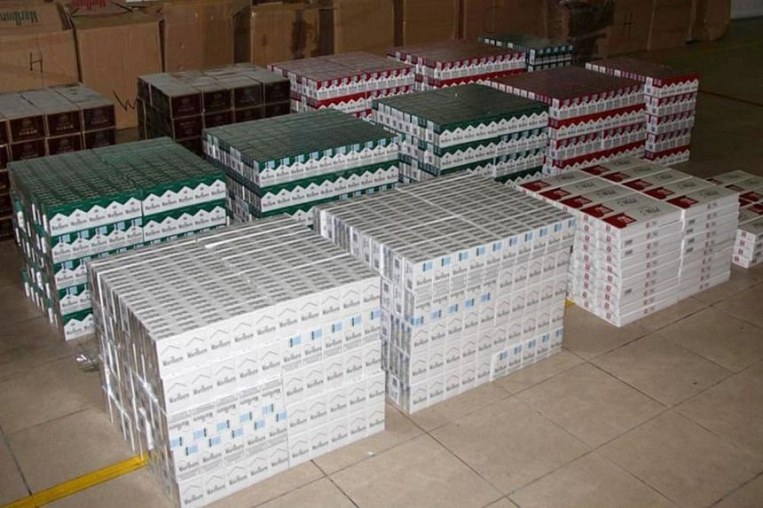 Five Singaporeans and two Indonesians were arrested for attempting to smuggle 22,900 packets of contraband cigarettes (pictured) valued at $240,303 into Singapore on Aug 4, 2012. Chief Justice Sundaresh Menon on Tuesday, April 15, 2014, laid down sen