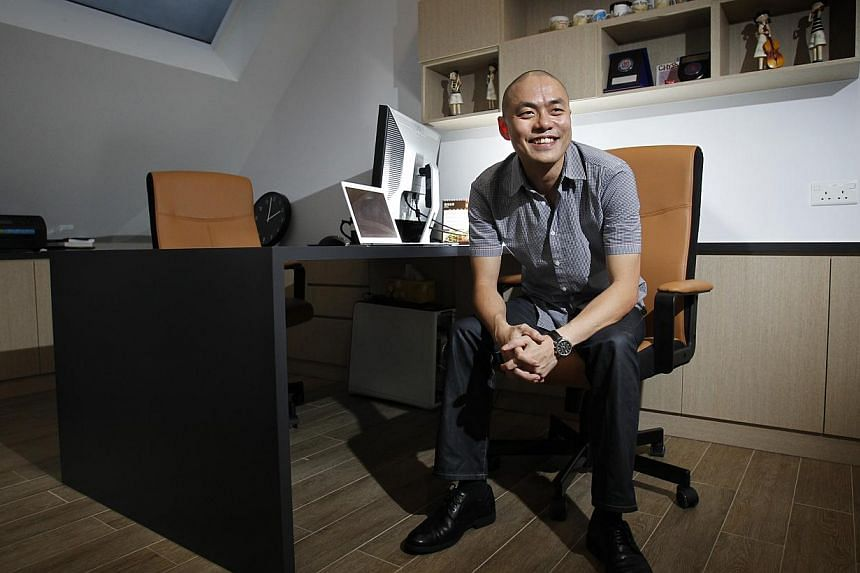 Mikhail Choo, a graduate of start-up accelerator Founder Institute Singapore, sold his tech firm Gridblaze, which he set up in 2011, to a US company in February 2013 for a seven-figure sum. -- ST PHOTO: KEVIN LIM
