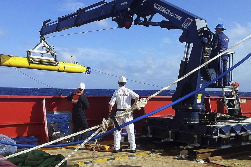 The Bluefin 21, the Artemis autonomous underwater vehicle (AUV), is hoisted back on board the Australian Defence Vessel Ocean Shield after a successful buoyancy test on April 4, 2014. The Bluefin-21 aborted its first search of the remote Indian