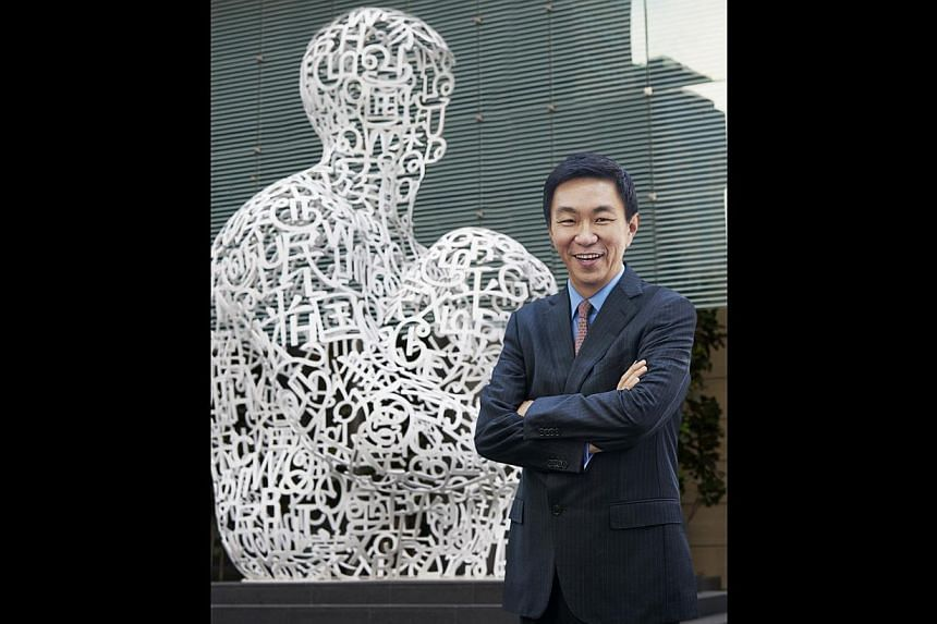 Keppel Corporation's CEO Loh Chin Hua with Jaume Plensa's Singapore Soul (above). The artwork and Anish Kapoor's Tall Tree In The Eye (right) are at the Ocean Financial Centre.
