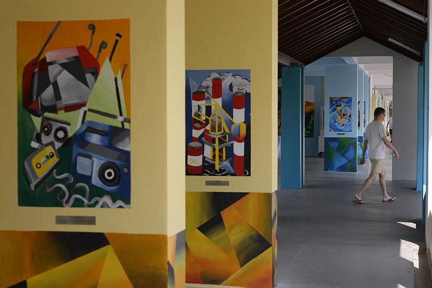 Mrs Karen Ngui, managing director and head of group strategic marketing and communications at DBS, with Henri Chen's Autumn Rocks (above). The bank also helped to put on the Void Deck Art Gallery @ Gek Poh Ville (left).