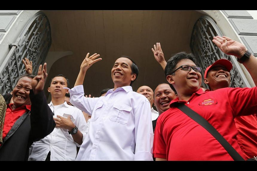 """Mr Joko """"Jokowi"""" Widodo (centre, in white) may be the new-generation leader a youthful electorate is looking for, but the party he represents, the Indonesian Democratic Party-Struggle, has its roots buried in the past. It got its act together too"""