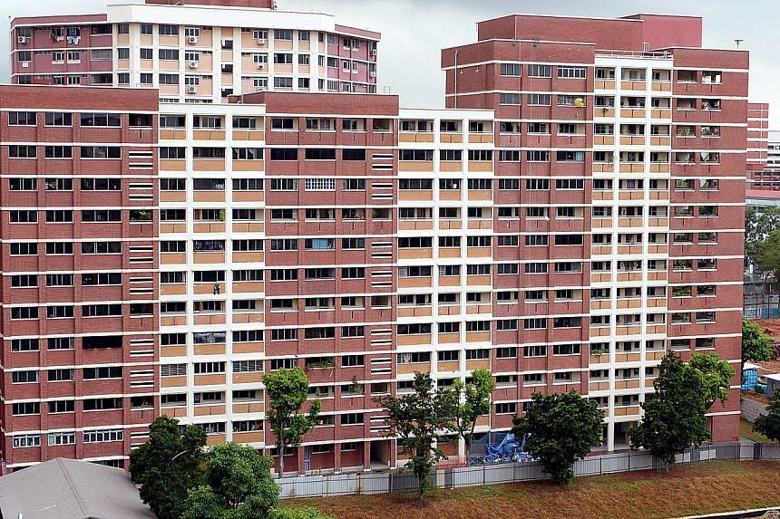 """This block (above) in Hougang Avenue 5 is among the 200 blocks islandwide that are unable to benefit from the Lift Upgrading Programme because of cost or architectural reasons. Mr Lee Yi Shyan said MND is """"piloting some possible (new technological) s"""