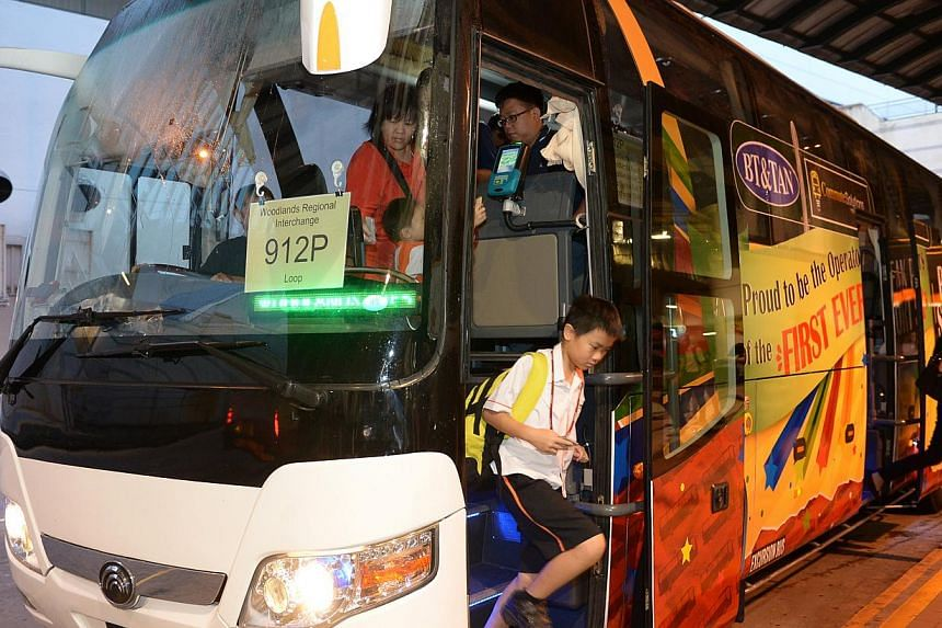 The first privately run feeder bus service, 912P, began plying the roads in Woodlands yesterday. The service will overlay the busiest stretches of feeder route 912 to reduce waiting times and ease congestion. -- ST PHOTO: JAMIE KOH