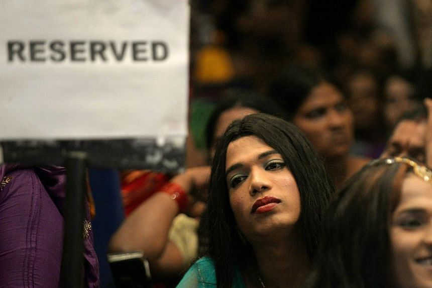 In this photograph taken on October 3, 2013, Indian transgenders attend a seminar for the transgender community in Mumbai. India's highest court on April 15, 2014 recognised the existence of a third gender that is neither male nor female, in a landma
