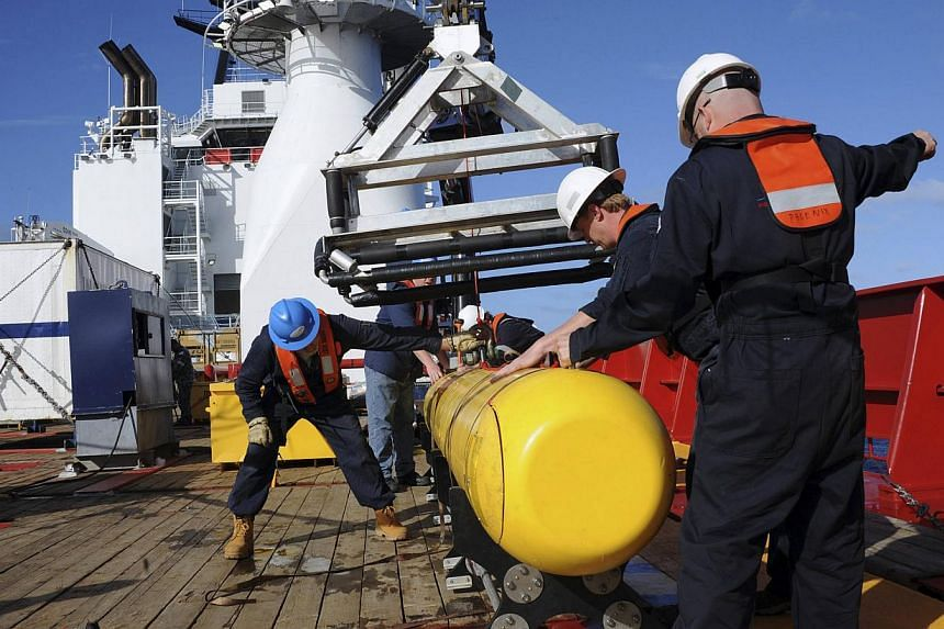The Bluefin 21, the Artemis autonomous underwater vehicle (AUV), is hoisted back on board the Australian Defence Vessel Ocean Shield after a successful buoyancy test on April 4, 2014. The Bluefin 21 prepared to make a second mission to the remote Ind