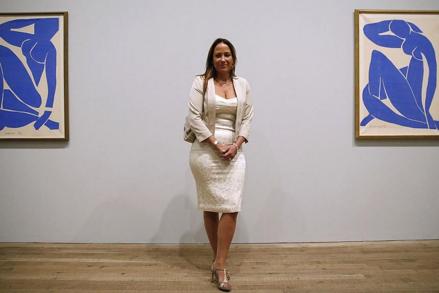 Ms Sophie Matisse, great granddaughter of artist Henri Matisse, poses with his artwork Blue Nude III (Nu Bleu III) (left) and Blue Nude II (Nu Bleu II) at the Tate Modern gallery in London on April 14, 2014. -- PHOTO: REUTERS