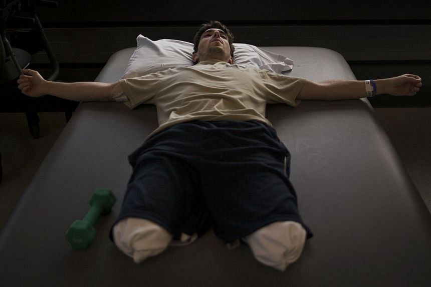The New York Times photographer Josh Haner's image of Jeff Bauman is shown in this picture provided by The New York Times which was part of his Pulitzer prize winning entry for feature photography announced by Columbia University in New York on April
