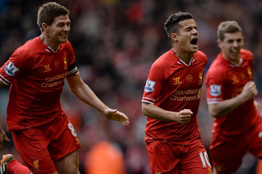 Liverpool's Philippe Courtinho (centre) celebrates scoring with Jon Flanagan (right) and Steven Gerrard against Manchester City during their English Premier League match at Anfield in Liverpoo on April 13, 2014. -- FILE PHOTO: REUTERS