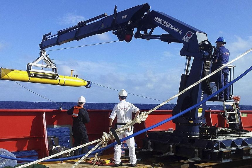 The Bluefin-21 autonomous underwater vehicle (AUV) is hoisted back on board the Australian Defence Vessel Ocean Shield after a successful buoyancy test in the southern Indian Ocean as part of the continuing search for the missing Malaysian Airlines f