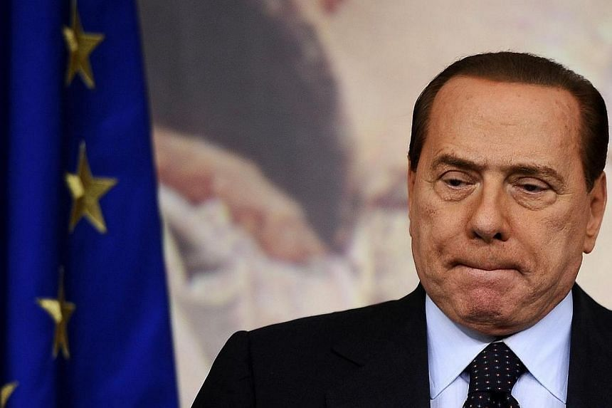A photo taken on Oct 22, 2010 shows Italian Prime Minister Silvio Berlusconi looking on during a press conference in Rome's Palazzo Chigi. An Italian court on Tuesday, April 15, 2014, ordered former prime minister and billionaire tycoon Silvio B