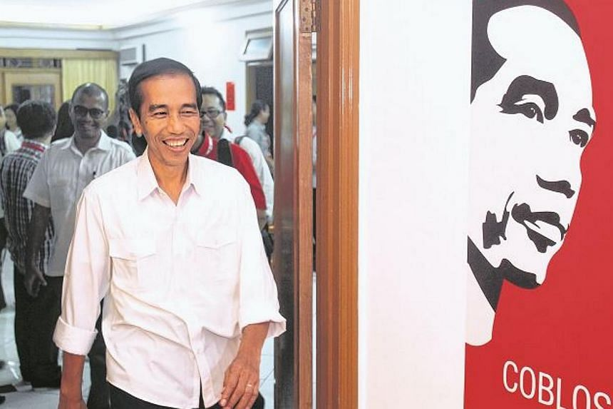 Jakarta governor Joko Widodo,the presidential candidate for the Indonesian Party of Struggle (PDIP).-- ST PHOTO:KEVIN LIM