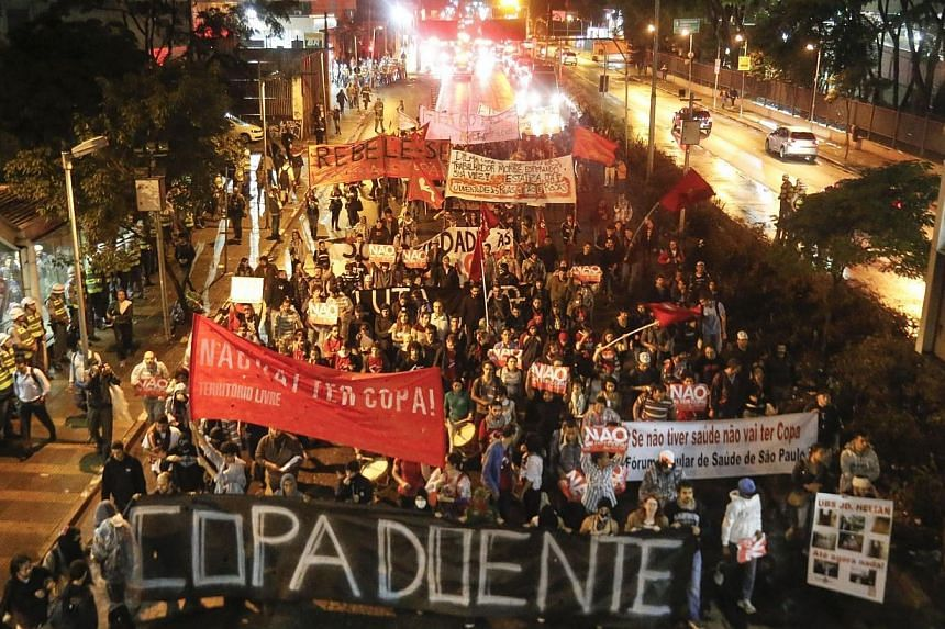 Demonstrators protest against the upcoming FIFA World Cup Brazil 2014 and demand better public transport services, in Sao Paulo, Brazil on April 15, 2014.Several hundred people marched through Brazil's biggest city on Tuesday in a peacefu