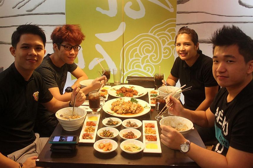 (From left) Singaporean Mr Ken Toh and his friends Mr Kenneth Lau, Ms Cristy Zafra and Mr Samuel Ang gathered at Hansang Restaurant dressed in black to eat jajangmyeon on April 14 - South Korea's Black Day. -- PHOTO: HANSANG KOREAN RESTAURANT