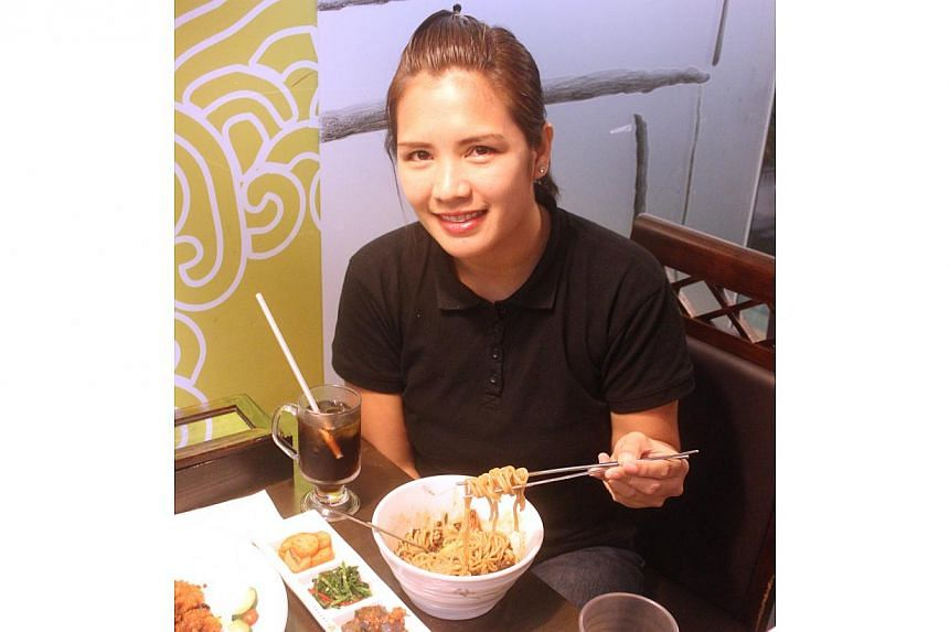 Filipino Ms Cristy Zafra, 30, experiencing her first Black Day in Singapore, alongside three guy friends. -- FILE PHOTO: HANSANG KOREAN RESTAURANT