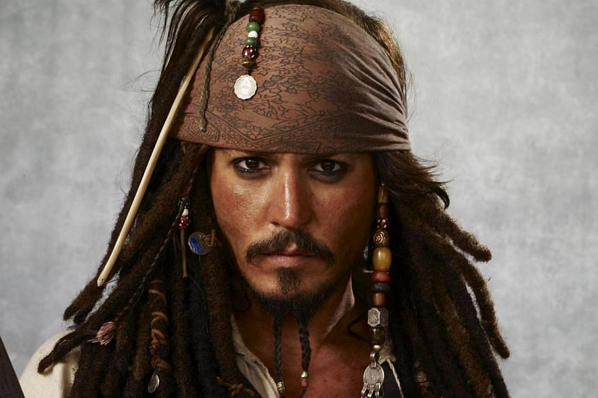 Actor Johnny Depp in Pirates Of The Caribbean: At World's End (above) and Alice In Wonderland, with former long-time partner, French actress and singer Vanessa Paradis, and fiancee Amber Heard. -- PHOTOS: AGENCE FRANCE-PRESSE, CHANEL, DISNEY, GOLDE