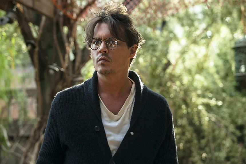 Johnny Depp in Transcendence. -- PHOTOS: AGENCE FRANCE-PRESSE, CHANEL, DISNEY, GOLDEN VILLAGE, SINGTEL