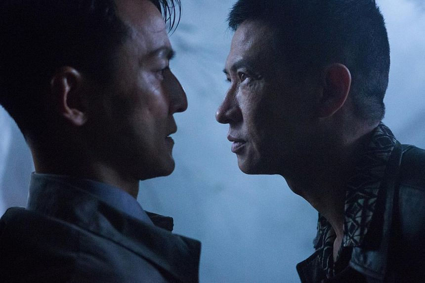 Daniel Wu (left) is the cop who unwittingly saves the ruthless criminal played by Nick Cheung (right). -- PHOTO: CLOVER FILMS