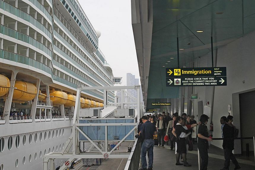 Travellers disembarking from a Royal Caribbean cruise ship in January. Passengers at the Marina Bay Cruise Centre Singapore have complained about long waits at the immigration checkpoints, and for taxis.